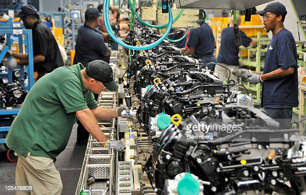 Hyundai team members inspect a batch of 24liter GDI engines on an assembly line in the engine building at the Hyundai Motor Manufacturing Alabama...
