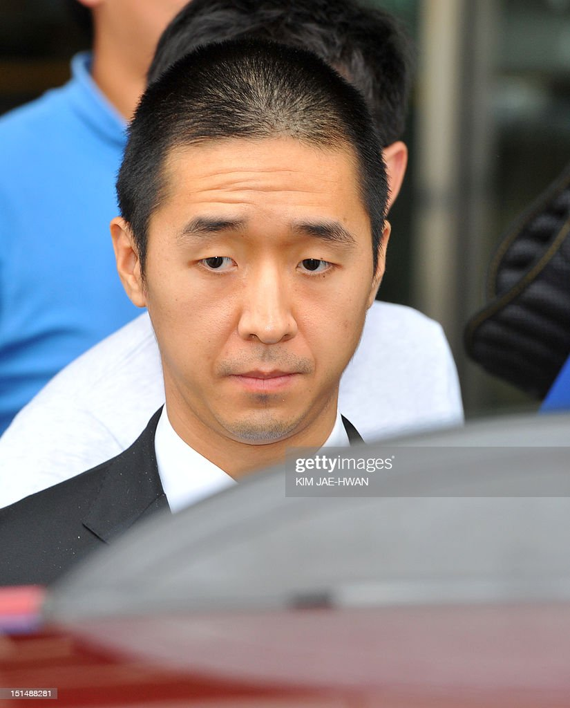 Hyung Jin Moon (L), the successor to Sun Myung Moon, the deceased founder of the Unification Church gets into a car after arriving at the border checkpoint at Dorasan in Paju on September 8, 2012, the route that leads to the Seoul-invested industrial estate in the North's Kaesong City. The youngest son and successor to Sun Myung Moon, the Unification Church's deceased founder, had a tearful reunion in North Korea with his aunt as they mourned Moon's death, a church official said. AFP PHOTO / KIM JAE-HWAN