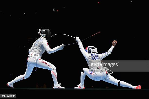 Hyunhee Nam of Korea and Shiho Nishioka of Japan compete during the women's individual foil on Day 5 of the Rio 2016 Olympic Games at Carioca Arena 3...