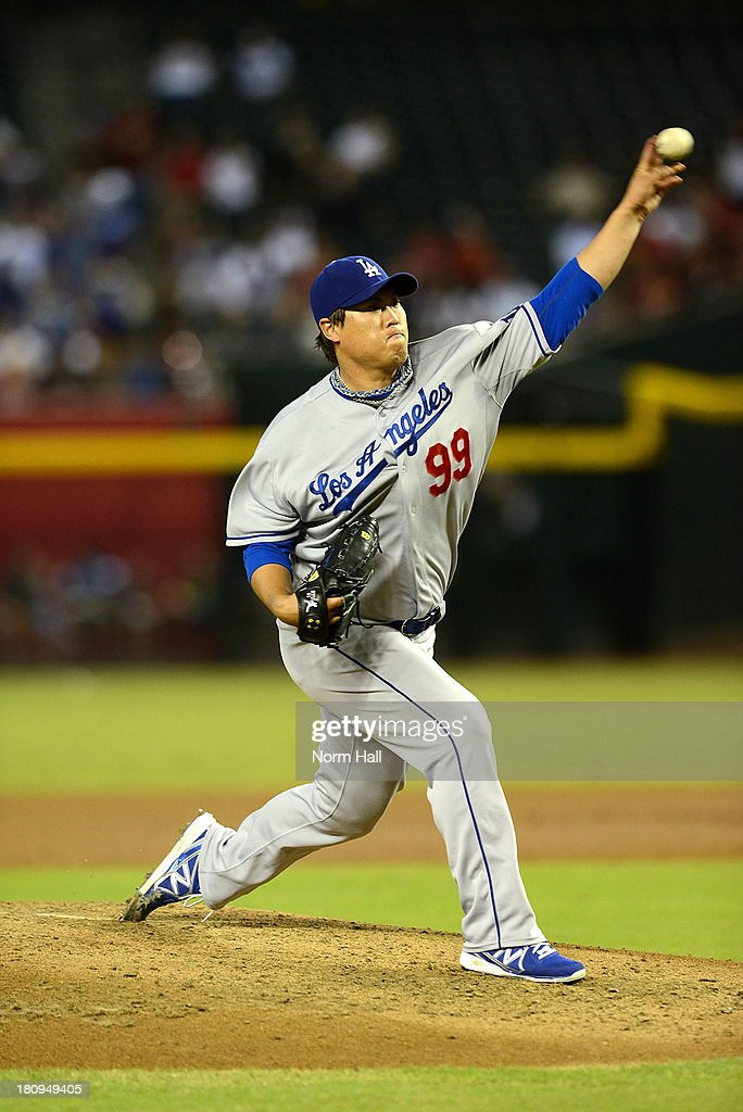 Hyun-Jin Ryu #99 of the Los Angeles Dodgers delivers a pitch against the Arizona Diamondbacks at Chase Field on September 16, 2013 in Phoenix, Arizona.