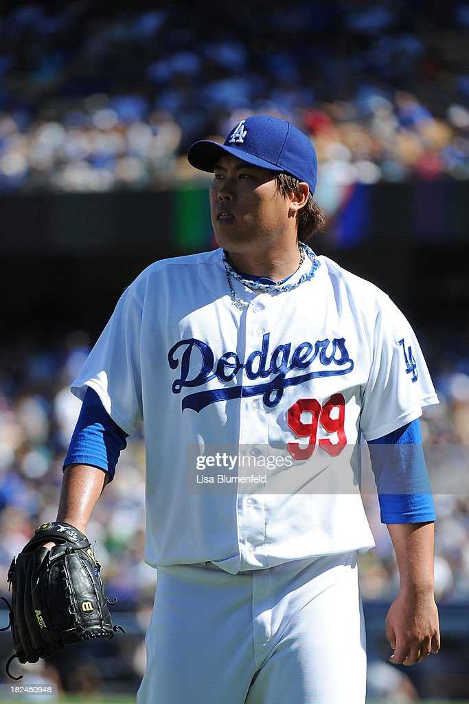 Hyun-Jin Ryu #99 of the Los Angeles Dodgers leaves the game in the fourth inning against the Colorado Rockies at Dodger Stadium on September 29, 2013 in Los Angeles, California.