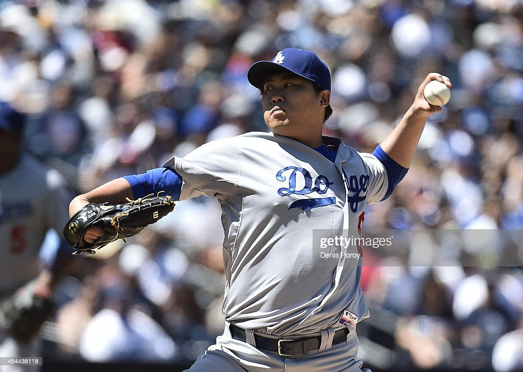Hyun-Jin Ryu #99 of the Los Angeles Dodgers pitches during the first inning of a baseball game against the San Diego Padres at Petco Park August, 31, 2014 in San Diego, California.
