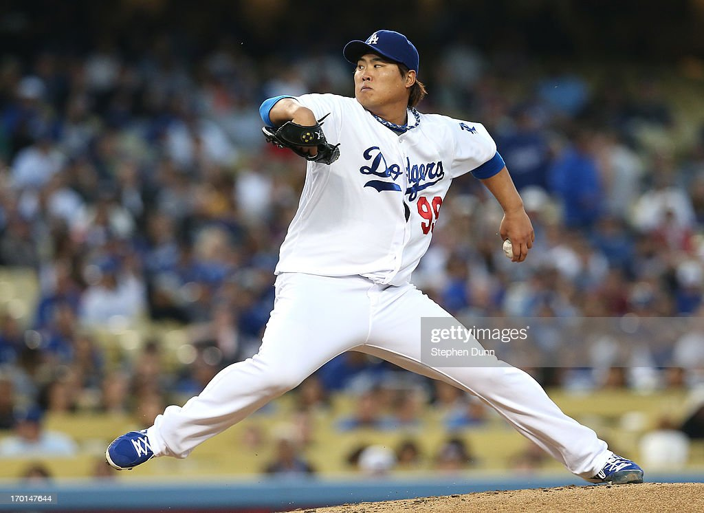 Hyun-Jin Ryu #99 of the Los Angeles Dodgers throws a pitch against the Atlanta Braves at Dodger Stadium on June 7, 2013 in Los Angeles, California.