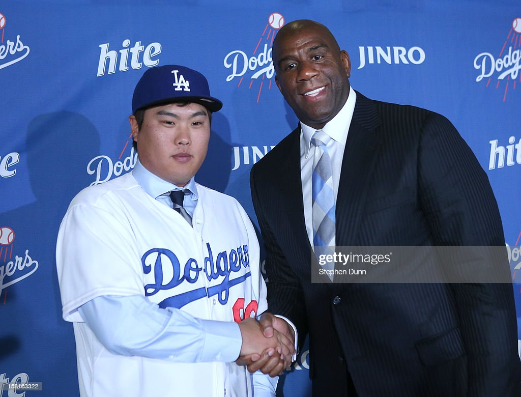 Hyun-Jin Ryu poses with Dodgers owner Ervin Magic Johnson at a press conference introducing him following his signing with the Los Angeles Dodgers at Dodger Stadium on December 10, 2012 in Los Angeles, California.