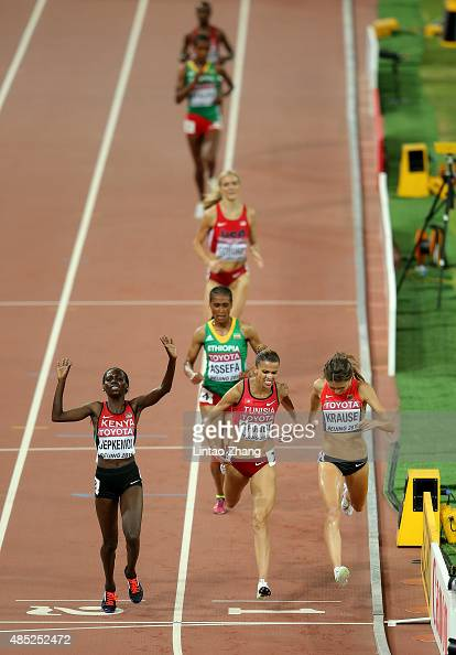 Hyvin Kiyeng Jepkemoi of Kenya celebrates after crossing the finish line to win gold in the Women's 3000 metres steeplechase final during day five of...