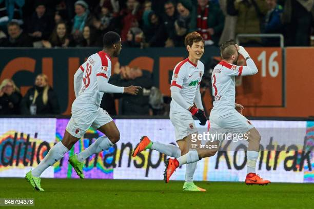 i Kevin Danso of Augsburg DongWon Ji of Augsburg and Konstantinos Stafylidis of Augsburg celebrate a goal during the Bundesliga match between FC...