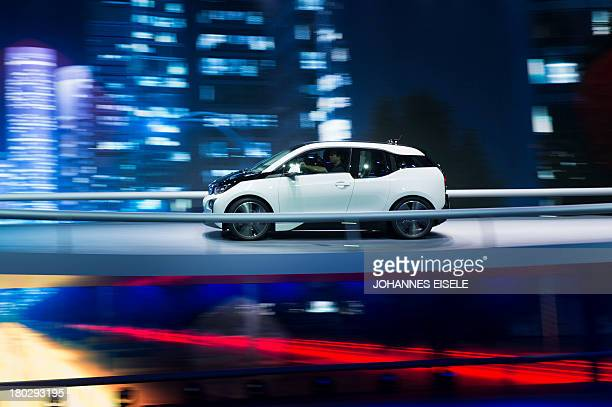 A BMW i3 car is tested at the BMW booth during the media day of the IAA international motor show in Frankfurt am Main western Germany on September 11...