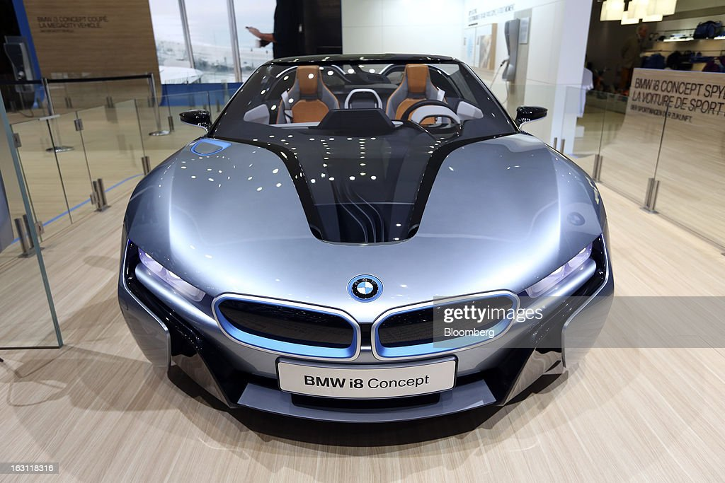 A BMW i8 concept automobile, produced by Bayerische Motoren Werke AG (BMW), is displayed on the company's stand ahead of the opening day of the 83rd Geneva International Motor Show in Geneva, Switzerland, on Monday, March 4, 2013. This year's show opens to the public on Mar. 7, and is set to feature more than 100 product premiers from the world's automobile manufacturers. Photographer: Chris Ratcliffe/Bloomberg via Getty Images