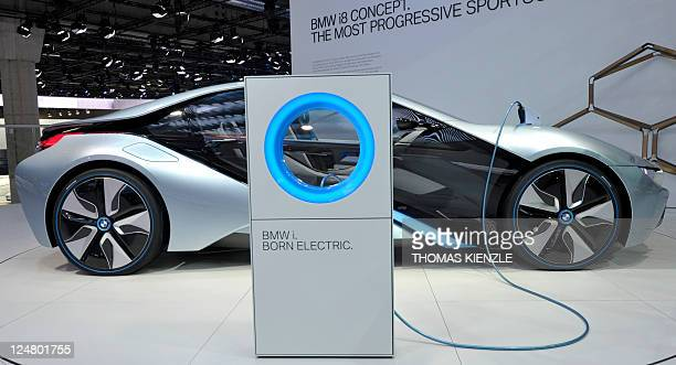 A BMW i8 concept car is connected to a charging station on the booth of German luxury car maker BMW at the international car show IAA in Frankfurt/M...