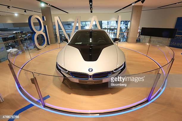 A BMW i8 plugin hybrid automobile manufactured by Bayerische Motoren Werke AG sits on display inside the BMW World showroom in Munich Germany on...