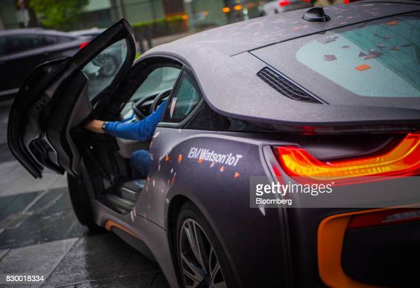 A BMW i8 plugin hybrid automobile manufactured by Bayerische Motoren Werke AG sits outside the International Business Machines Corp Watson cognitive...