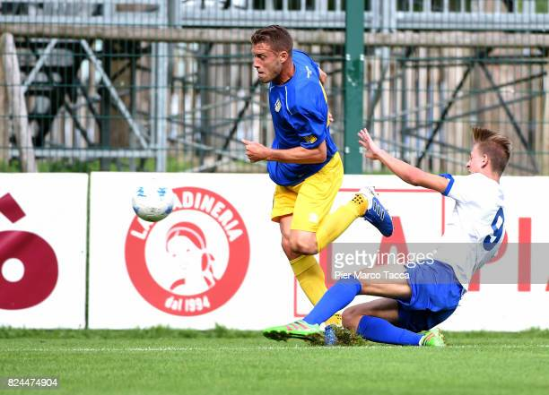 Iacopini Simone of Parma Calcio competes for the ball with Lorenzo Mapelli of Dro during the preseason friendly match between Parma Calcio and Dro on...