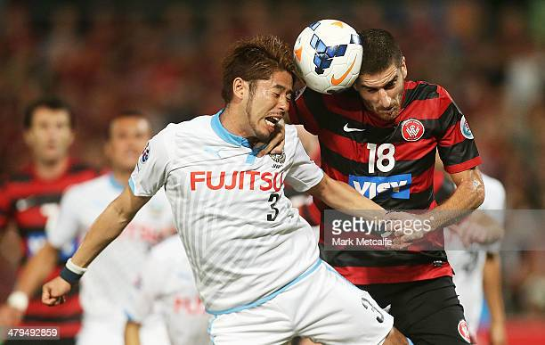 Iacopo La Rocca of the Wanderers and Yusuke Tanaka of Frontale compete for the ball during the AFC Asian Champions League match between the Western...