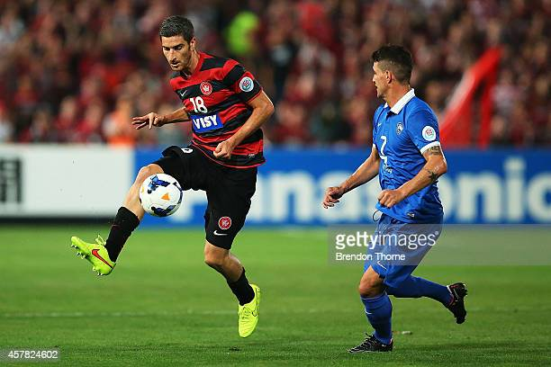 Iacopo La Rocca of the Wanderers ccompetes with Thiago Neves of AlHilal during the Asian Champions League final match between the Western Sydney...