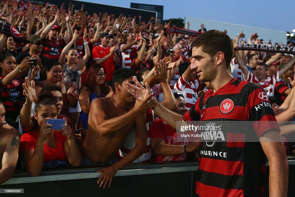 Iacopo La Rocca of the Wanderers celebrates with the crowd after victory in the round 14 A-League match between the Western Sydney Wanderers and the Melbourne Victory at Parramatta Stadium on January 1, 2013 in Sydney, Australia.