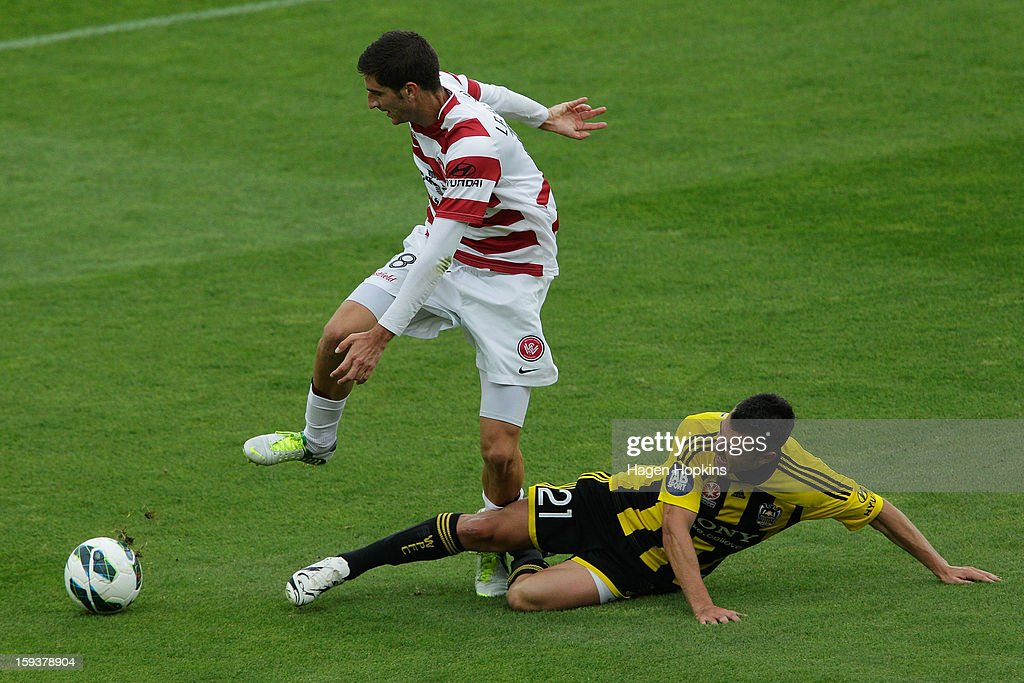 Iacopo La Rocca of the Wanderers is tackled by Dani Sanchez of the Phoenix during the round 16 A-League match between the Wellington Phoenix and the Western Sydney Wanderers at Westpac Stadium on January 13, 2013 in Wellington, New Zealand.