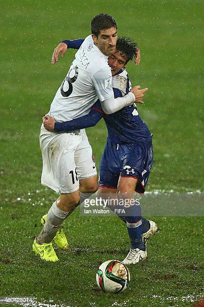 Iacopo La Rocca of WS Wanderers FC and Mauro Formica of Cruz Azul in action during the FIFA Club World Cup Quarter Final match between Cruz Azul FC v...