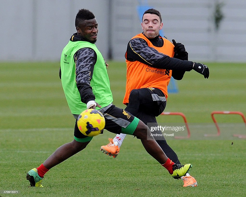 <a gi-track='captionPersonalityLinkClicked' href=/galleries/search?phrase=Iago+Aspas&family=editorial&specificpeople=6700373 ng-click='$event.stopPropagation()'>Iago Aspas</a> and Yalany Baio of Liverpool in action during a training session at Melwood Training Ground on February 21, 2014 in Liverpool, England.