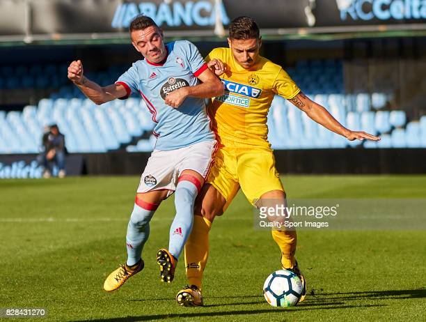 Iago Aspas of Celta de Vigo competes for the ball with Giuseppe Pezzella of Udinese Calcio during the Pre Season Friendly match between Celta de Vigo...