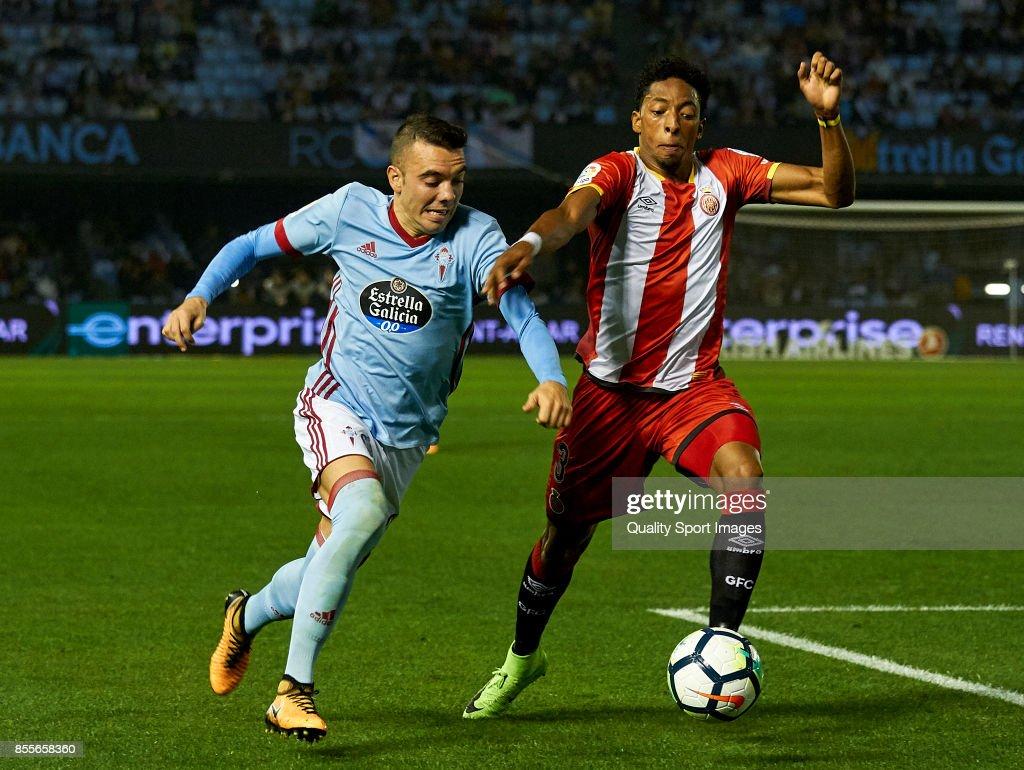 Iago Aspas (L) of Celta de Vigo competes for the ball with Johan Andres Mojica of Girona FC during the La Liga match between Celta de Vigo and Girona at Balaidos Stadium on September 29, 2017 in Vigo, Spain.