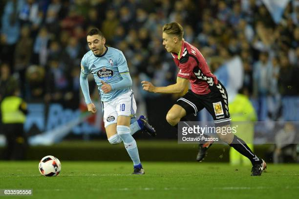 Iago Aspas of Celta de Vigo competes for the ball with Marcos Llorente of Alaves during the Copa del Rey semifinal first leg match between Real Club...