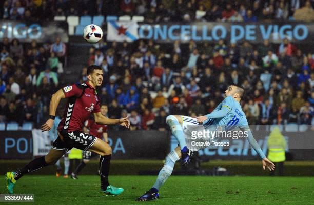 Iago Aspas of Celta de Vigo competes for the ball with Zouhair Feddal of Alaves during the Copa del Rey semifinal first leg match between Real Club...