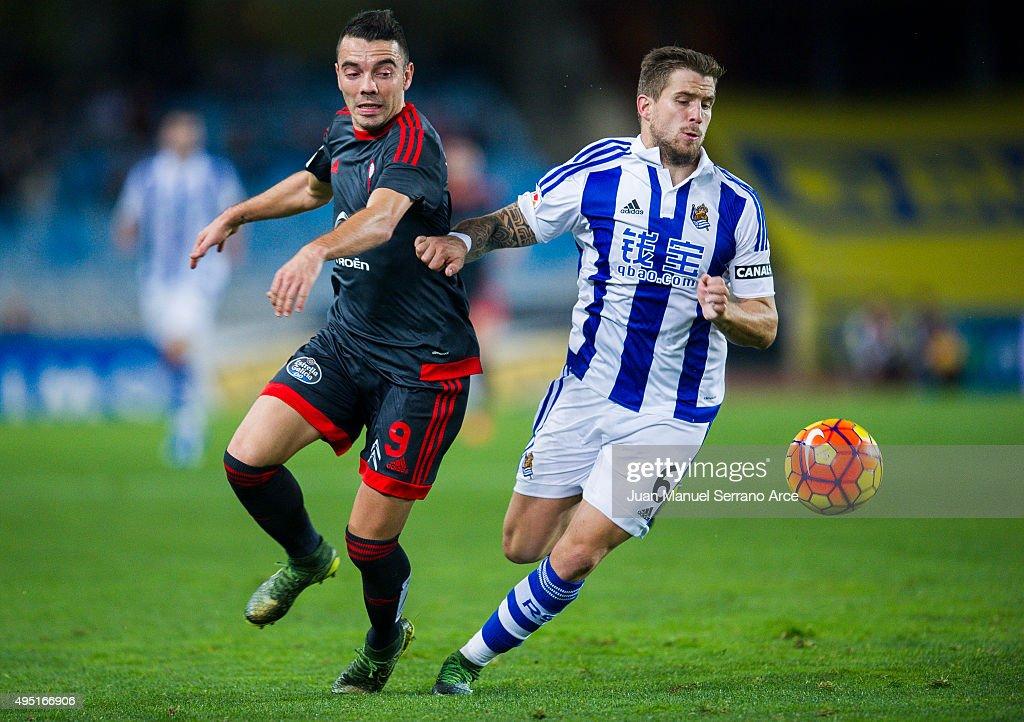 Iago Aspas of Celta de Vigo duels for the ball with Inigo Martinez of Real Sociedad during the La Liga match between Real Sociedad de Futbol and...