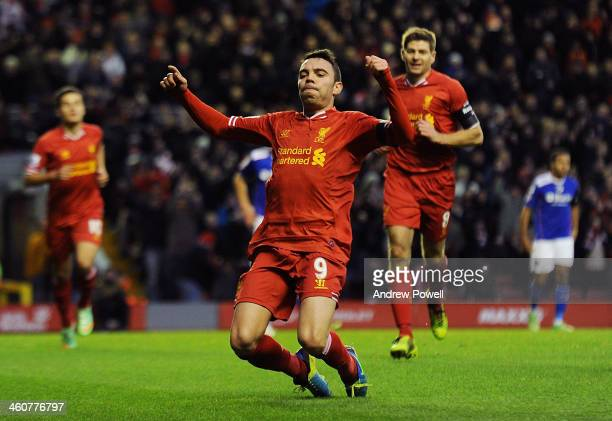 Iago Aspas of Liverpool celebrates his goal to make it 10 during the Budweiser FA Cup Third Round match between Liverpool and Oldham Athletic at...