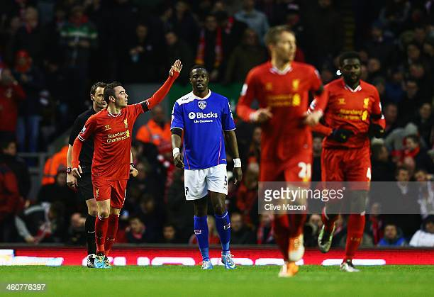 Iago Aspas of Liverpool celebrates scoring the opening goal during the Budweiser FA Cup third round match between Liverpool and Oldham Athletic at...