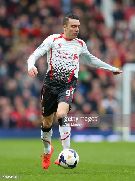 Iago Aspas of Liverpool in action during the Barclays Premier League match between Manchester United and Liverpool at Old Trafford on March 16 2014...