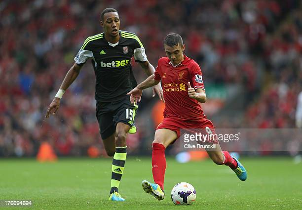 Iago Aspas of Liverpool in action with Steven N'Zonzi of Stoke City during the Barclays Premier League match between Liverpool and Stoke City at...