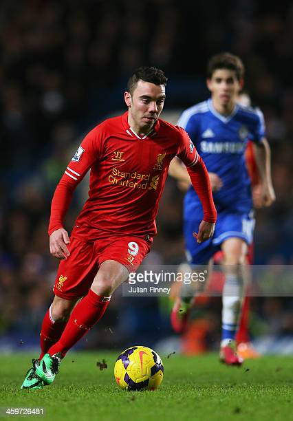 Iago Aspas of Liverpool runs with the ball during the Barclays Premier League match between Chelsea and Liverpool at Stamford Bridge on December 29...
