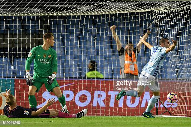 Iago Aspas of RC Celta de Vigo scores a goal against FC Barcelona during the La Liga match between Real Club Celta de Vigo and Futbol Club Barcelona...