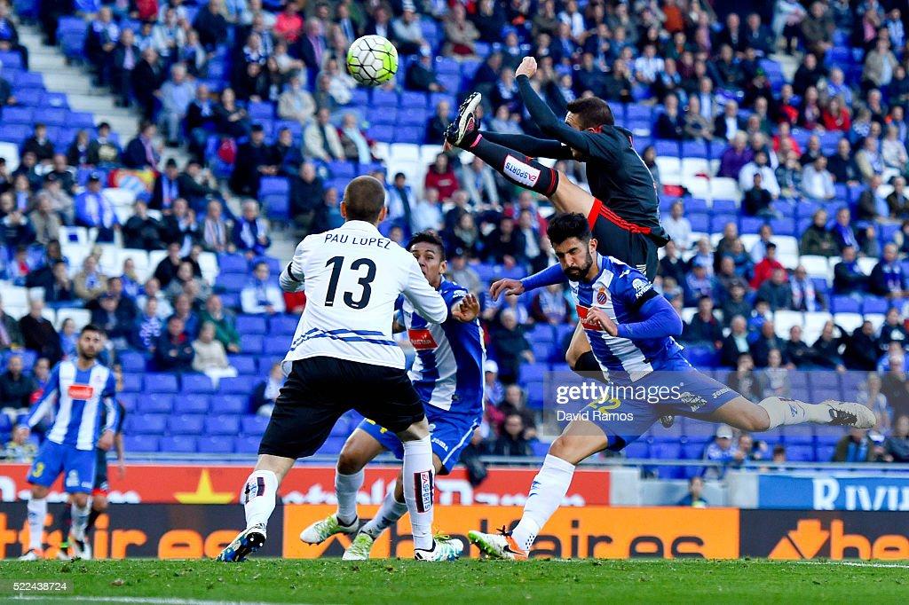 <a gi-track='captionPersonalityLinkClicked' href=/galleries/search?phrase=Iago+Aspas&family=editorial&specificpeople=6700373 ng-click='$event.stopPropagation()'>Iago Aspas</a> of RC Celta de Vigo scores the opening goal past <a gi-track='captionPersonalityLinkClicked' href=/galleries/search?phrase=Alvaro+Gonzalez+-+Soccer+Player&family=editorial&specificpeople=2261829 ng-click='$event.stopPropagation()'>Alvaro Gonzalez</a> (R) Antonio Raillo (C) and Pau Lopez of RCD Espanyol during the La Liga match between Real CD Espanyol and Celta Vigo at Cornella-El Prat Stadium on April 19, 2016 in Barcelona, Spain.