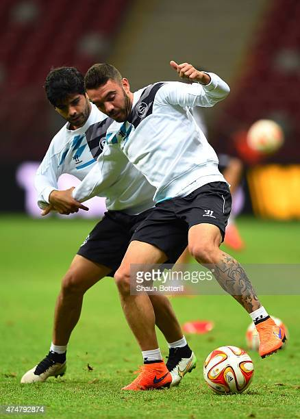 Iago Aspas of Sevilla is closed down by Ever Banega of Sevilla during an FC Sevilla training session on the eve of the UEFA Europa League Final...
