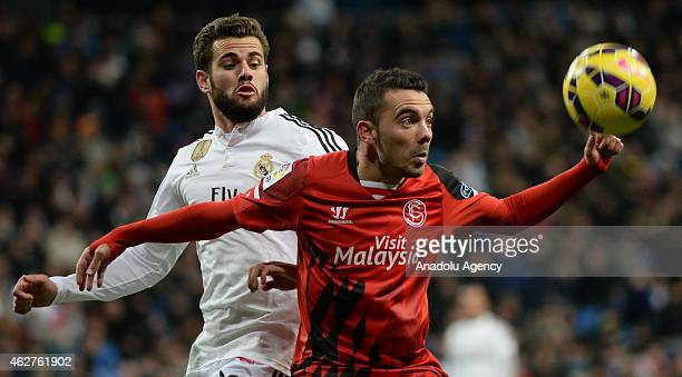 Iago Aspas of Sevilla vies for the ball with Nacho of Real Madrid during the La Liga match between Real Madrid and Sevilla FC at Santiago Bernabeu...