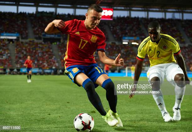 Iago Aspas of Spain is closed down by Cristian Zapata of Colombia during the international friendly match between Spain and Colombia at Nueva...