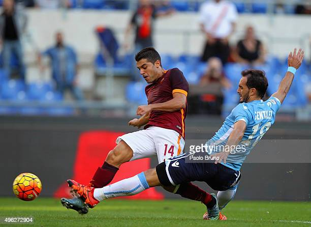 Iago Falque of AS Roma competes for the ball with Santiago Gentiletti of SS Lazio during the Serie A match between AS Roma and SS Lazio at Stadio...