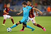 Iago Falque of AS Roma competes for the ball with Sergi Roberto of FC Barcelona during the UEFA Champions League Group E match between AS Roma and FC...