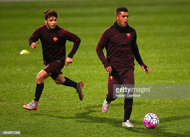 Iago Falque of AS Roma is chased by Daniel De Silva during an AS Roma training session at Lakeside Stadium on July 16 2015 in Melbourne Australia