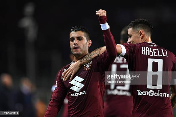 Iago Falque of FC Torino celebrates after scoring the opening goal with team mate Daniele Baselli during the Serie A match between FC Torino and AC...
