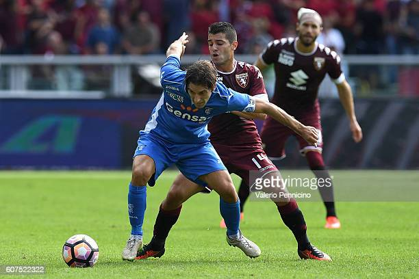 Iago Falque of FC Torino competes with Daniele Croce of Empoli FC during the Serie A match between FC Torino and Empoli FC at Stadio Olimpico di...