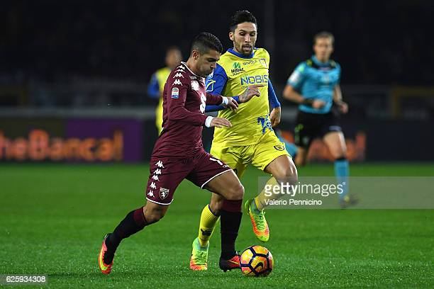 Iago Falque of FC Torino in action against Lucas Nahuel Castro of AC ChievoVerona during the Serie A match between FC Torino and AC ChievoVerona at...