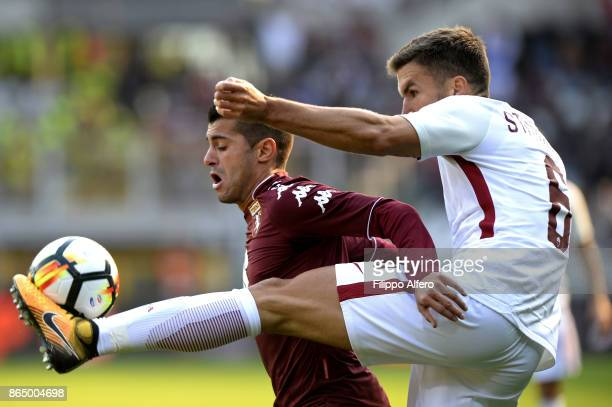 Iago Falque of Torino and Kevin Strootman of AS Roma compete for the ball during the Serie A match between Torino FC and AS Roma at Stadio Olimpico...
