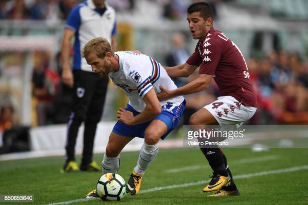 Iago Falque of Torino FC competes with Ivan Strinic of UC Sampdoria during the Serie A match between Torino FC and UC Sampdoria at Stadio Olimpico di...