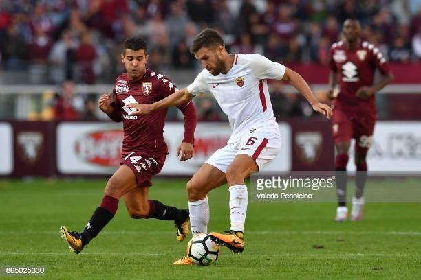 Iago Falque of Torino FC competes with Kevin Strootman of AS Roma during the Serie A match between Torino FC and AS Roma at Stadio Olimpico di Torino...