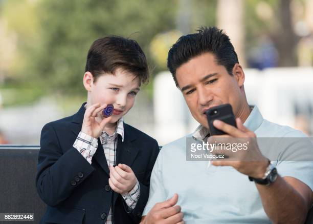 Iain Armitage shows off his rock to Mario Lopez at 'Extra' at Universal Studios Hollywood on October 18 2017 in Universal City California