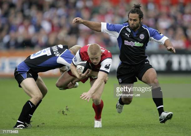 Iain Balshaw of Gloucester is tackled by Michael Stephenson of Bath during the Guinness Premiership match between Gloucester and Bath at Kingsholm...