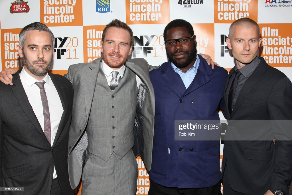 Iain Canning Michael Fassbender director Steve McQueen and James Badge Dale attend the 49th annual New York Film Festival presentation of 'Shame' at...