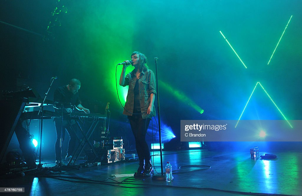 Iain Cook and <a gi-track='captionPersonalityLinkClicked' href=/galleries/search?phrase=Lauren+Mayberry&family=editorial&specificpeople=10104078 ng-click='$event.stopPropagation()'>Lauren Mayberry</a> of Chvrches perform on stage at The Forum on March 14, 2014 in London, United Kingdom.